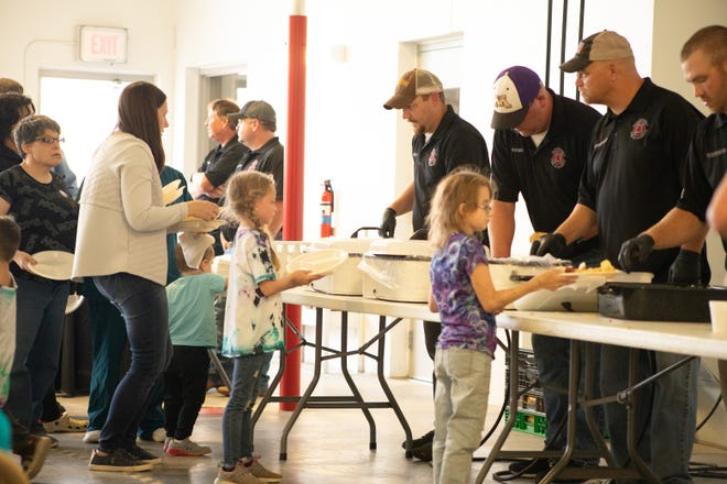 The community gathered with a line across the Fire Hall parking lot for the community meal served by Montevideo's volunteer Fire Department members.