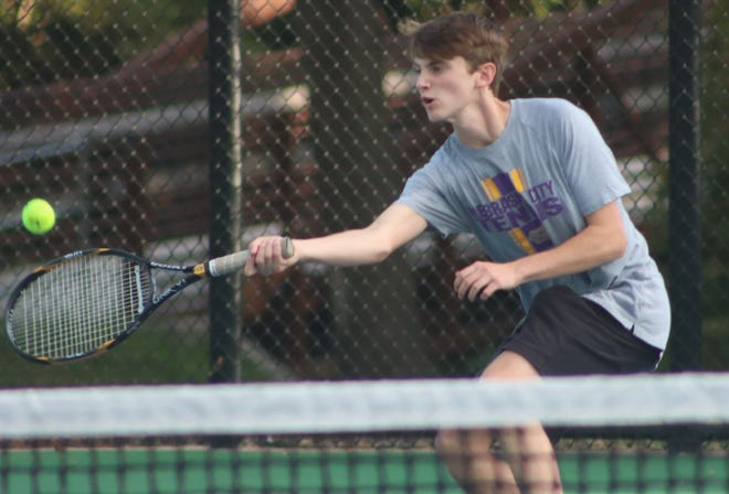 Eli McNeely of the NCHS boys' tennis team competes during a home match.