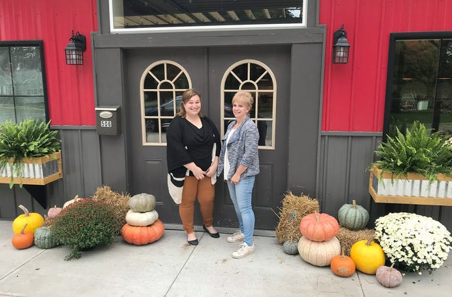 Kaylee Sierson, left, and Kathy Roberts stand at the door to The Coffee Tree Oct. 7 in Sherrill.