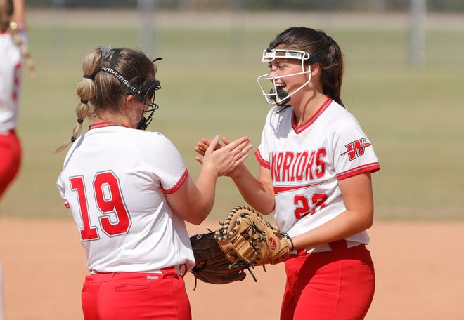 WashingtonÕs Maggie Place (19) and Emjay Lucas (23) celebrate an out against Coalgate during an OSSAA Class 3A softball game at Hall of Fame Stadium in Oklahoma City on Friday, Oct. 8, 2021. Photo by Alonzo Adams for The Oklahoman.