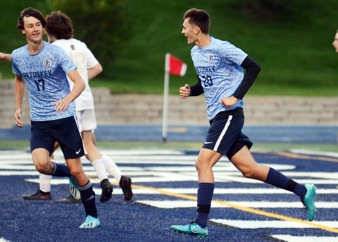 The Petoskey High School boys' soccer team including Ben Shuman (left) and Marek Beckering earned a 2-1 win on the road Thursday at Traverse City Central. With the win, the Northmen improve to 14-3-2 overall, 7-2 league and will close regular season play on Wednesday at Gaylord.