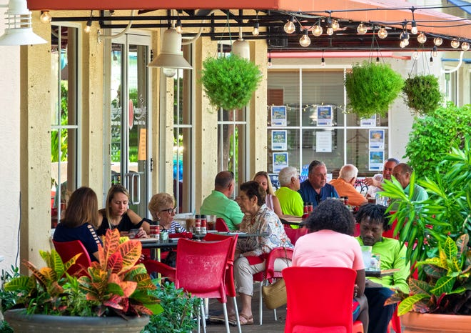 Diners lunch outside at Prosecco Café in PGA Commons Thursday, Oct. 7, 2021 in Palm Beach Gardens. The city is setting new regulations about outdoor dining.