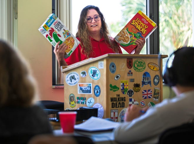 Carrie Andersen teaches a science lesson about hypotheses at The Andersen Academy in Jupiter Thursday, Oct. 7, 2021. Andersen quit her job as an English teacher at Jupiter High when her boss demanded she give up working remotely and teach in-person despite health conditions that put Andersen at greater risk for severe illness should she catch COVID-19. Now Andersen is teaching about 15 middle schoolers whose parents have decided to have them home schooled. She's one of more than 150 teachers who quit in the first two months of the school year. The lesson involved a question about iron in fortified cereal.