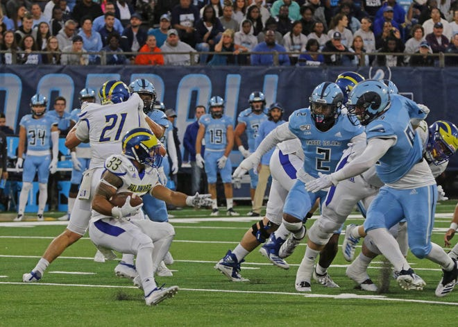 URI defenders close in on Delaware's Johnny Buchanan in a 2019 game at Meade Stadium. The Blue Hens won in triple-overtime, 44-36.