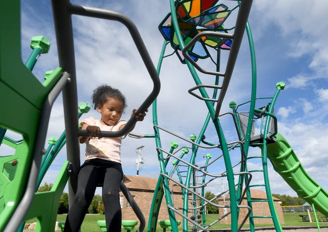 Koume Hinton, 4, of Canton enjoys a warmer than usual October Friday on the playground at Weis Park in Canton. The National Weather Service says warmer temperatures are expected to stick around for awhile in Northeast Ohio.