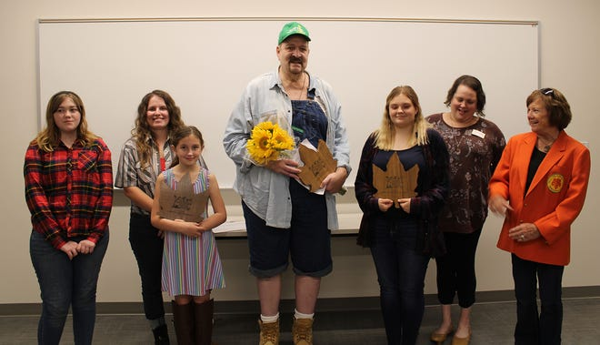 The 2021 Morgan County Fall Foliage Festival Poetry Contest winners were announced earlier this week. Those who received awards include Sarah Shively (left), Second Place Adult; Alanna Taylor, First  Place Middle School; Violet Leitzman, First Place Elementary; Michael Weaver, first Place adult, Adiana Taylor, Third Place Middle School; Jennifer McKinney, Morgan County Public Library; Judy Byres, Fall Foliage Festival board member. Not pictured are Kenneth Kennedy, Second Place Elementary; Otis Kennedy, Second Place Middle School; Danielle Ice, Third Place Adult.