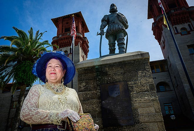 Author Ann Colby, dressed as Madam Blanche Travis Altavilla, stands in front of the Lightner Building in St. Augustine last month.