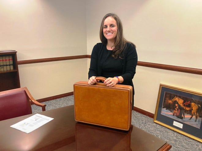 St. Johns County Judge Lauren Blocker, who was appointed by Gov. Ron DeSantis, holds her father's briefcase in her office at the St. Johns County courthouse. Her father, who died when she was a baby, was an attorney. Local officials advocated for a third judge to help with the demands placed on the court system from population growth.