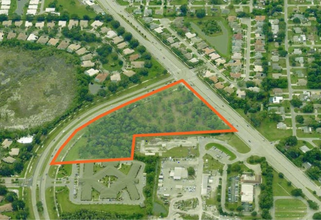 The parcel outlined in red was sold Wednesday by Englewood Bank & Trust Company to Home Planet Real Estate. The curved road at left is Jacaranda Boulevard, while the diagonal road at right is State Road 776. The viewpoint is from the north.