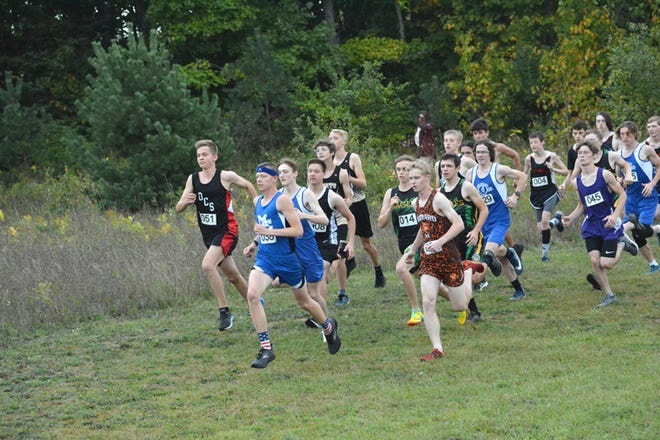 Lars Huffman of Mackinaw City takes the early lead in the EUPC I meet at Newberry. Huffman also won at Naubinway in the EUPC II meet this past week. Brimley's boys and the St. Ignace girls lead team results in the conference, finishing first in both meets.
