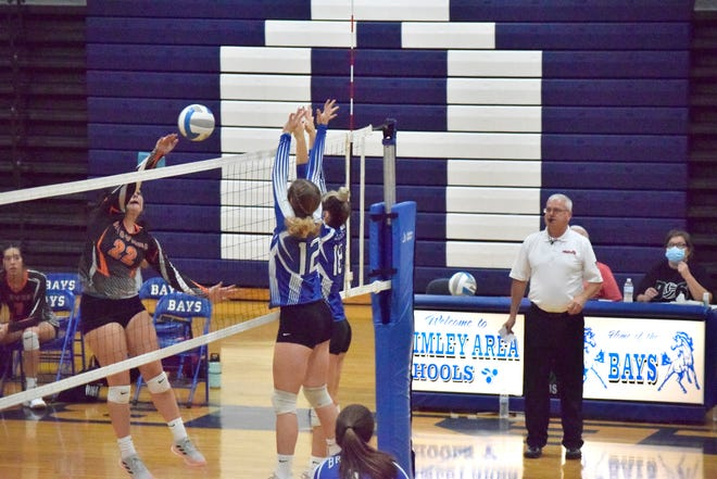 Brimley's Alana VanderMeer and Lindsey Hill block at the net during a match against Rudyard Thursday. The Bulldogs beat the Bays 3-0 in the EUPC match.