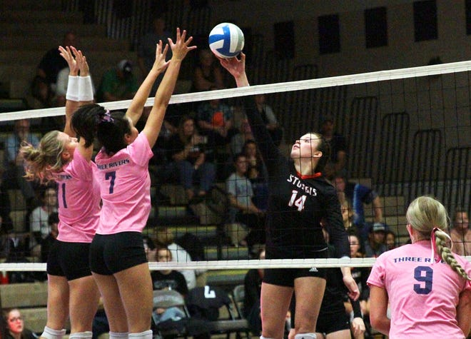 Megan Hecht of Sturgis wins a ball above the net against Three Rivers in prep volleyball action on Thursday.
