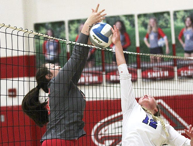 Autumn Herlein of Constantine blocks a tip attempt over the net in prep volleyball action on Thursday.