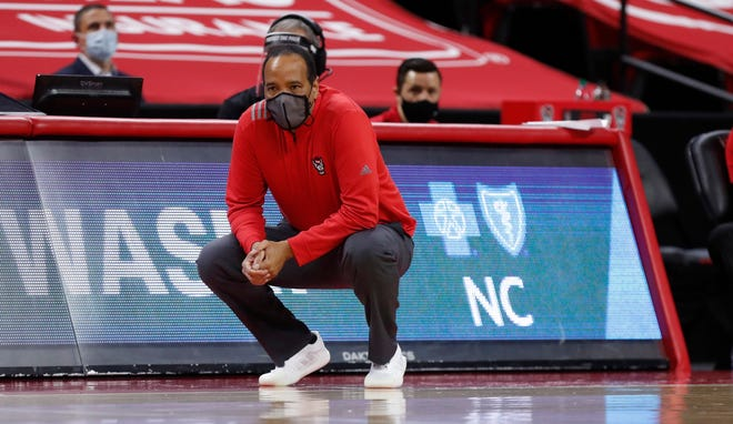 North Carolina State's head coach Kevin Keatts watches during the first half of an NCAA college basketball game against Syracuse Tuesday, Feb. 9, 2021 in Raleigh, N.C.