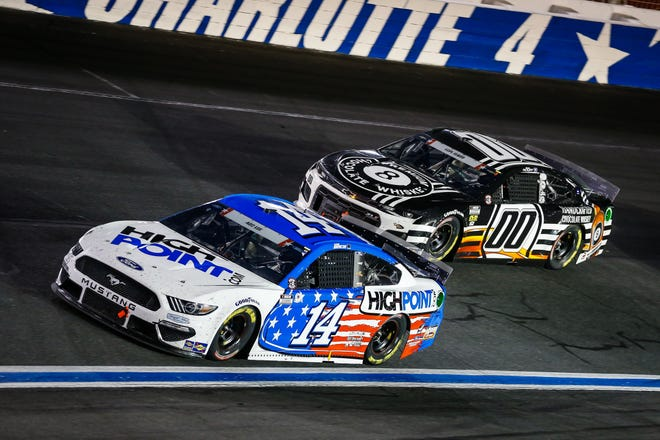 Mitchell's Chase Briscoe (14) leads Quin Houff (00) during the Coca-Cola 600 at Charlotte Motor Speedway in May.