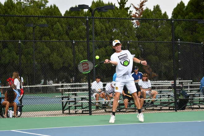 Pueblo County High School senior Dean DeCarlo hits a forehand during his 6-0, 6-0 win over Mesa Ridge's Diego Martin at the Class 4A Region 7 boys tennis tournament at Pueblo City Park on Oct. 8, 2021.
