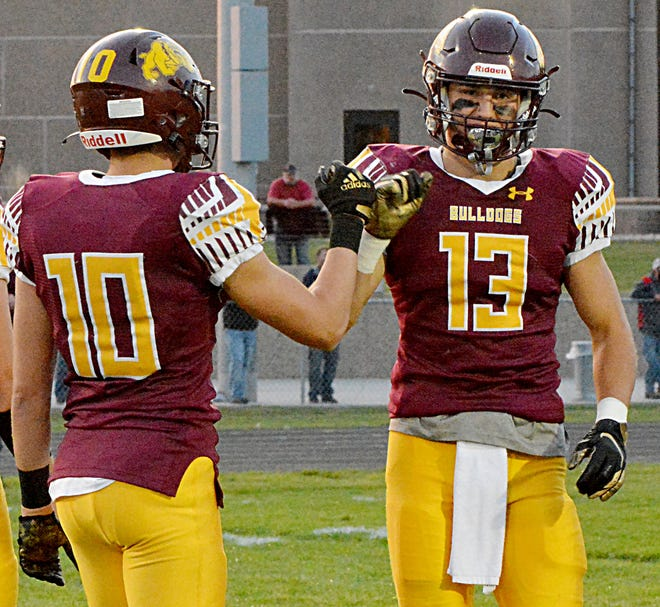 Seniors Rett Osthus (10) and Kalen Garry (13) did their part to keep De Smet's top-rated Class 9A high school football team remain unbeaten Thursday with a win over Castlewood. Osthus and Garry lead the Public Opinion's list of top area football performers this week.