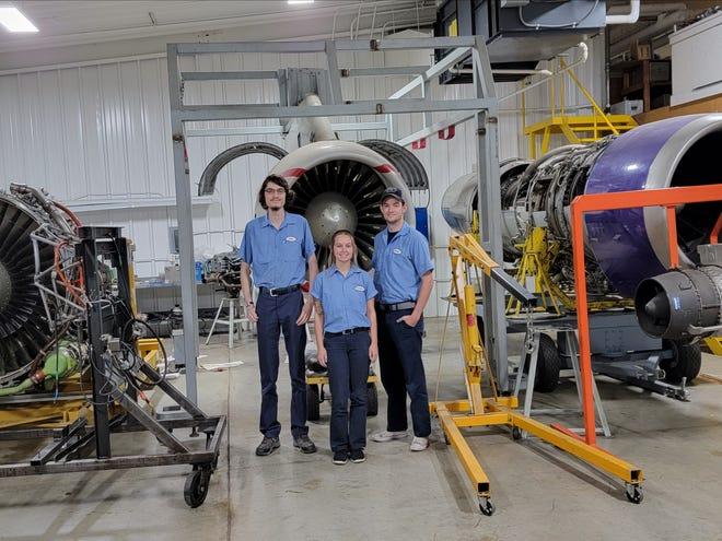 Lake Area aviation maintenance students Sam Burke, left, Brooklyn Swenson and Dalton Mann in the school's hanger.