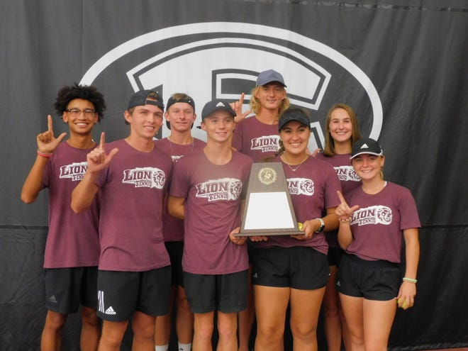 Ennis senior tennis team members gather for a photo with the trophy after clinching the District 14-5A championship. Back row (from left): Jayden Davis, Daniel Janousek, Christopher Nicholson, Victoria Berry; front row: Dylan Gunn, Chance Kozlovsky, Ella Goedrich, Abigail Fritzsche.