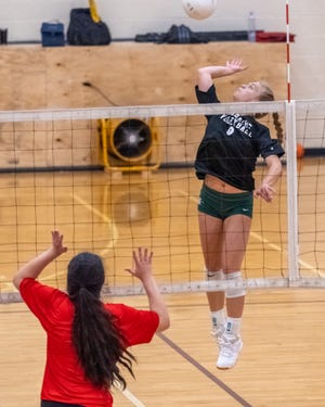 Waxahachie's Amber Morgan goes up for a kill during a preseason scrimmage against Red Oak.
