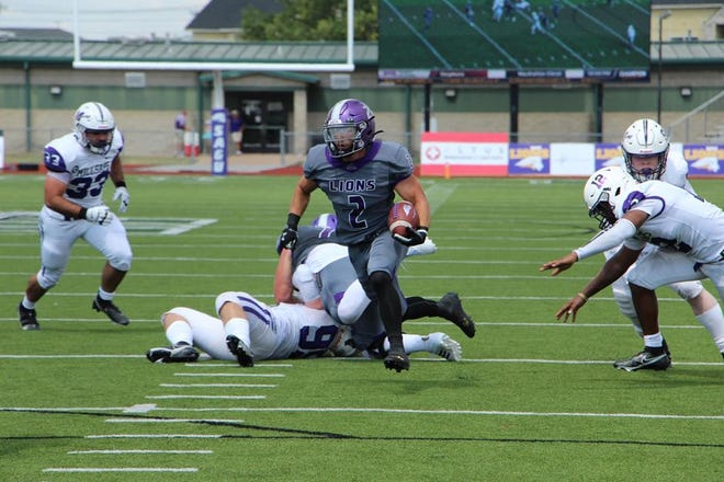 SAGU's Keaton Dudik bursts free up the middle during the Lions' home game against Millsaps at Lumpkins Stadium.