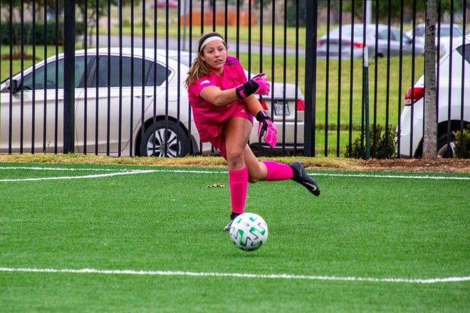 SAGU women's soccer goalkeeper Zoe Boldt makes a play on the ball during a recent match.