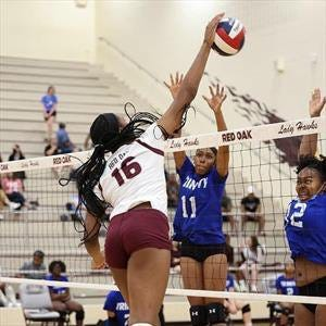 Red Oak's Kennedy Washington goes up high for a kill during a previous home match.