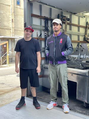 """Set dressers Joseph Melendez, left, and Malique McLaren at Westerman Prop House in Worcester picking up set pieces for the filming of """"Salem's Lot."""" Both Melendez and McLaren are IATSE union members."""