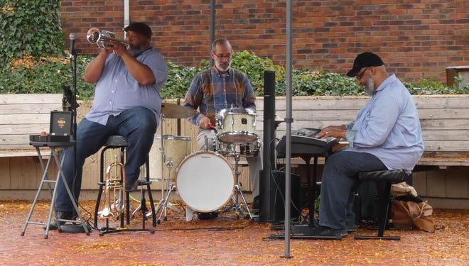The Jeffrey Boyd Trio performs in downtown Crestline on Thursday evening.