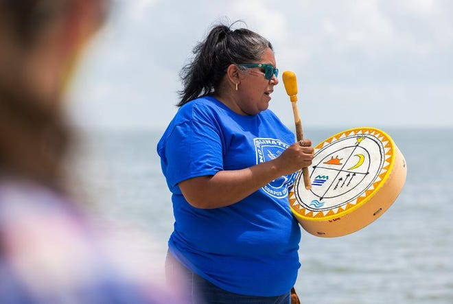 Love Sanchez, a Karankawa Kadla woman who co-founded the nonprofit group Indigenous Peoples of the Coastal Bend, participates in a ceremony on McGee Beach to protest industrial expansion in Corpus Christi Bay.