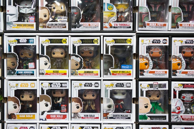 Pop Funko figurines are one of the items Cotten's Collectibles sells. A wall is dedicated specifically to these collectible commodities.