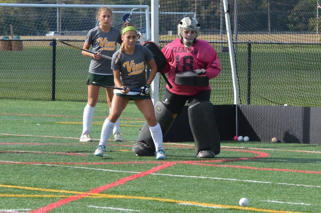 Clearview junior goalie Christina Unger holds off Darian DeLeo in warmups