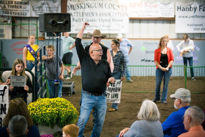 Tim Wise served as a ringman pointing our bidders during the sale of champions Thursday at the Coshocton County Fair.