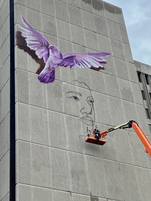 A mural is being painted on the Frank Murphy Hall of Justice. Artist Carlos Alberto is on day two of the project which is a part of Street Art for Mankind's Zero Hunger initiative.