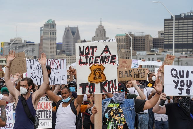 Protesters march through Detroit on the sixth day of protests against police brutality on Friday, June 5, 2020.