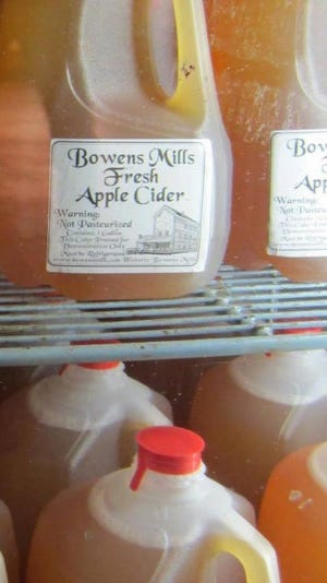 State officials Friday urged consumers not to drink apple cider made by Bowens Mills.