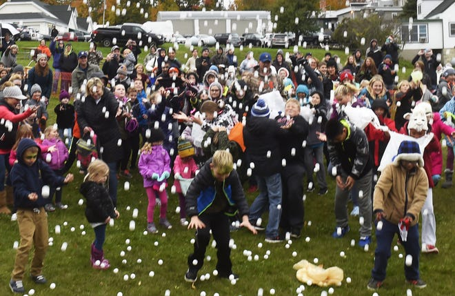 Sunday afternoon's pingpong ball drop, with prizes from local businesses available on most of the balls, is an annual highlight of Fall Fest, which holds its 75th edition of the festival Oct. 15 to 17.