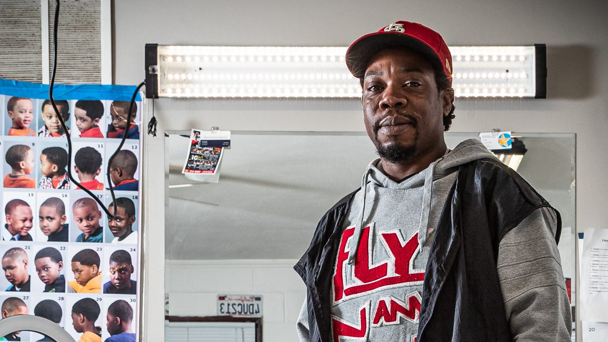 Tommy Dotson waits for his first customer of the day inside his barbershop, T.E.DÕZ Barbershop, on Indianapolis' south side Friday, Oct. 8, 2021. Dotson used $15,000 of his savings, money left to him by his mother, to repair the old building and opened in February 2020, One month later COVID-19 forced him to shut down. This was one of a series of obstacles Dotson has faced along the way to opening the shop, but despite the obstacles, he remains optimistic.