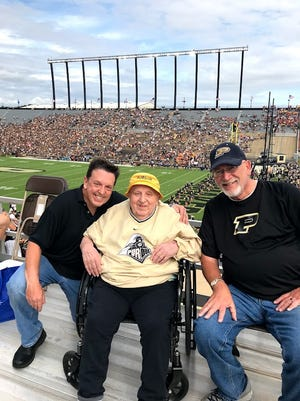 Retired pharmacist and Purdue fan Mickey Kor, center, attended the Sept. 28, 2019, Purdue football game with his son, Alex, left, and friend Joe Youngblood. The Boilermakers came back to nearly beat Minnesota, ultimately losing 38-31. Weakened by illness, Kor still refused to leave Ross-Ade Stadium early.