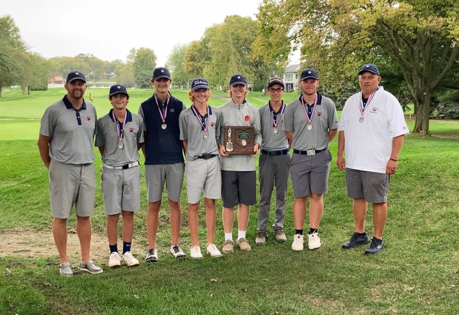 The Galion boys golf team poses with its plaque after placing second at the Division II District Tournament on Thursday at the Catawba Island Club. The Tigers are headed back to the state tournament for the fifth straight season.