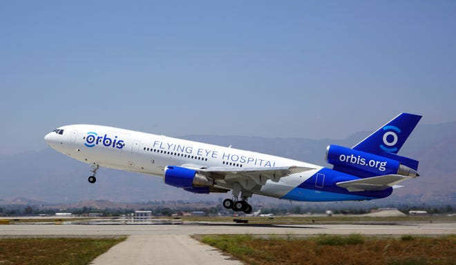 The first official takeoff of the newly completed and painted MD-10 Flying Eye Hospital in San Bernardino, California, in June 2016. The plane was heading to LAX for the official launch.