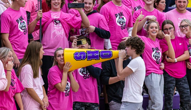 Oconomowoc's Katelyn Duero and Tobey Moylan carry on a conversation in the student section during the girls volleyball match against Muskego on Thursday, Oct. 7, 2021.