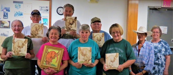 Members of the North Arkansas Woodcarvers Club recently conducted a Pyrography Class. Participants include: (first row)Nancy Smith, Lynn Huett, Sherry Valentine, Amy Wainscott, Pam Frost, instructor Myrna McCurley; (second row) Elmer Tankerley, Terry Muth and Bob Axel.