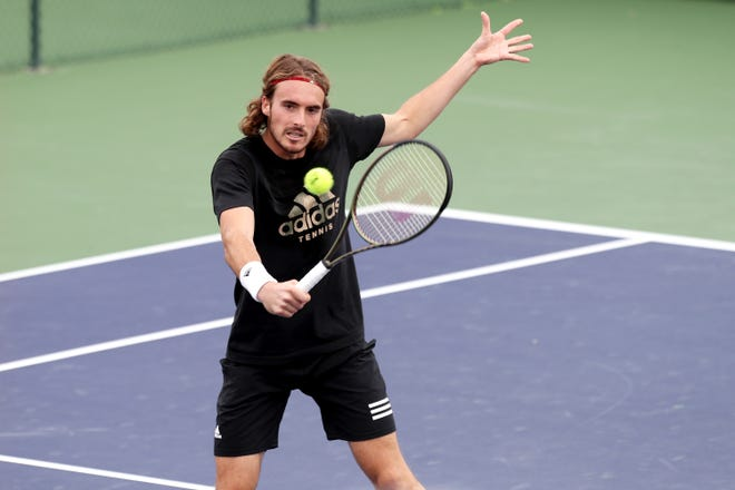 Stefanos Tsitsipas of Greece returns a shot during a practice session at the BNP Paribas Open in Indian Wells, Calif., on October 8, 2021.