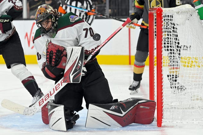 Arizona Coyotes goaltender Karel Vejmelka deflects the puck during the second period of the team's NHL preseason hockey game against the Vegas Golden Knights on Thursday, Oct. 7, 2021, in Las Vegas.