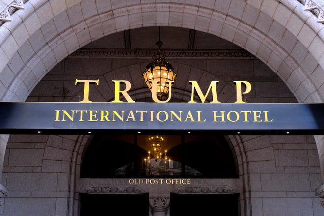 FILE - This March 11, 2019 file photo, shows the north entrance of the Trump International in Washington.  Former President Donald Trump's company lost more than $70 million operating his Washington D.C. hotel while in office, forcing him at one point get a reprieve from a major bank on payments on a loan, according to documents released Friday, Oct. 8, 2021, by a House committee investigating his business. (AP Photo/Mark Tenally, File)