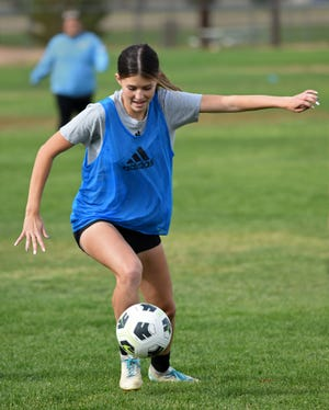 Reed's Rylee Husted kicks the ball during practice on Oct. 7, 2021.