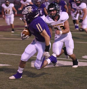 Goldthwaite High School's Seth Gardner (33) closes in on a San Saba ball carrier in a District 4-2A Division I football game Thursday, Oct. 7, 2021, at Gordon Wood Stadium in Brownwood.