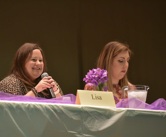 Lisa Riddle, 39, speaks on a panel about domestic violence during Take Back The Night on Thursday, Oct. 7, 2021.