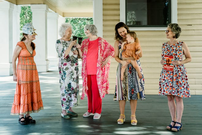 """From left, Linda Hall, Eleanor Dietrich, Lynne Knight, Becki Rutta with daughter Eden, and Mary Jane Ryals put together the """"Women Among Us"""" exhibit opening at LeMoyne on Oct. 14."""